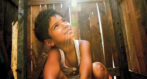 Ayush Mahesh Khedekar in 'Slumdog Millionaire'